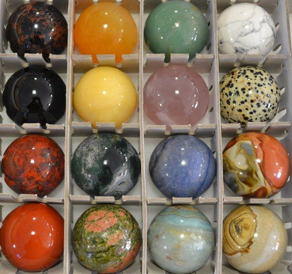 """Assortment of gem types in spheres, representing """"wholenesss"""""""
