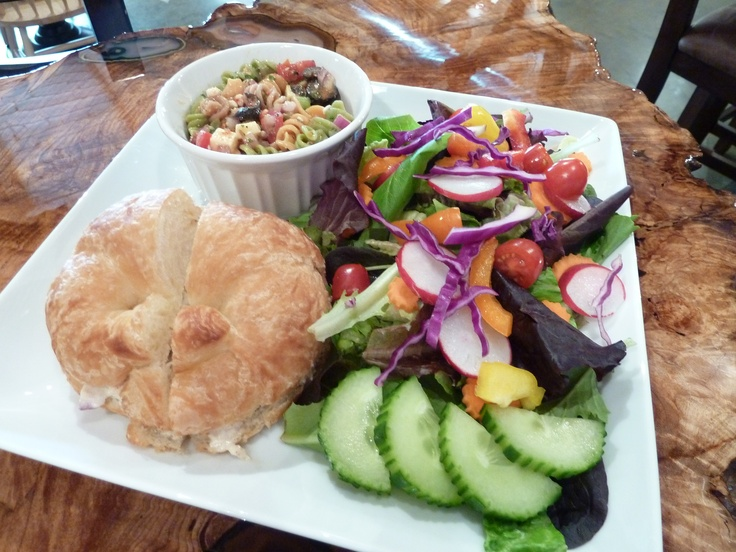 ladies luncheon - trio of salads (chicken salad on croissant, fresh green salad, and pasta salad)