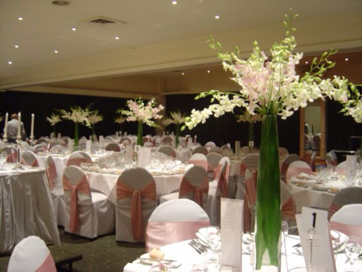 Pink and white chair overs with tall tower vase by www.newminsterfunctiondesign.com
