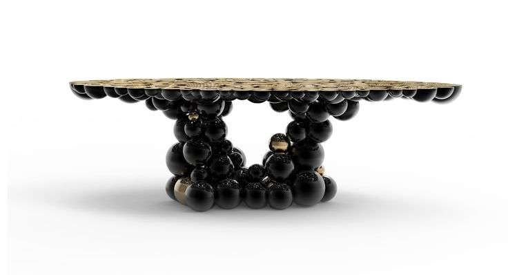 The Newton Dining Table id made of black lacquer brass spheres with high gloss varnish finishing and some gold plated spheres on the base | www.bocadolobo.com #bocadolobo #luxuryfurniture #exclusivedesign #interiodesign #designideas #diningtable #newton