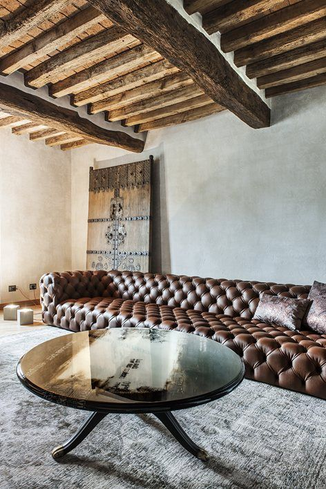 these rustic rafters and the couch!! wood and leather combined perfectly