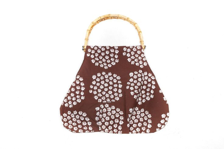 Handbag made of vintage fabric in brown and white.