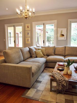 large sectional couch area with light brown tones