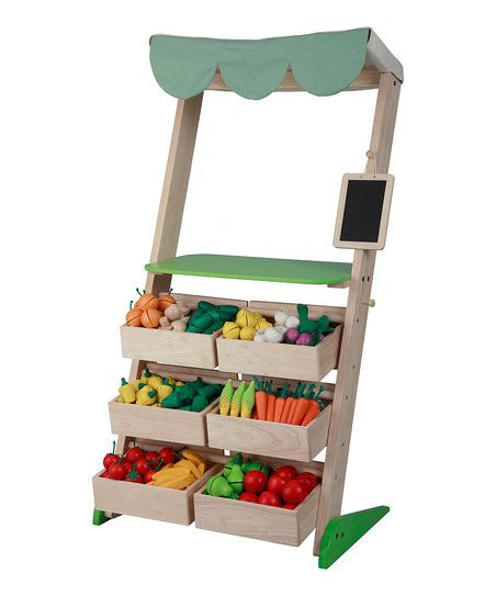 Make a trip to the bustling market with this cheerful play set that showcases a plentiful produce stall! With a variety of fruits and veggies, little vendors explore the world of retail with this colorful stand.