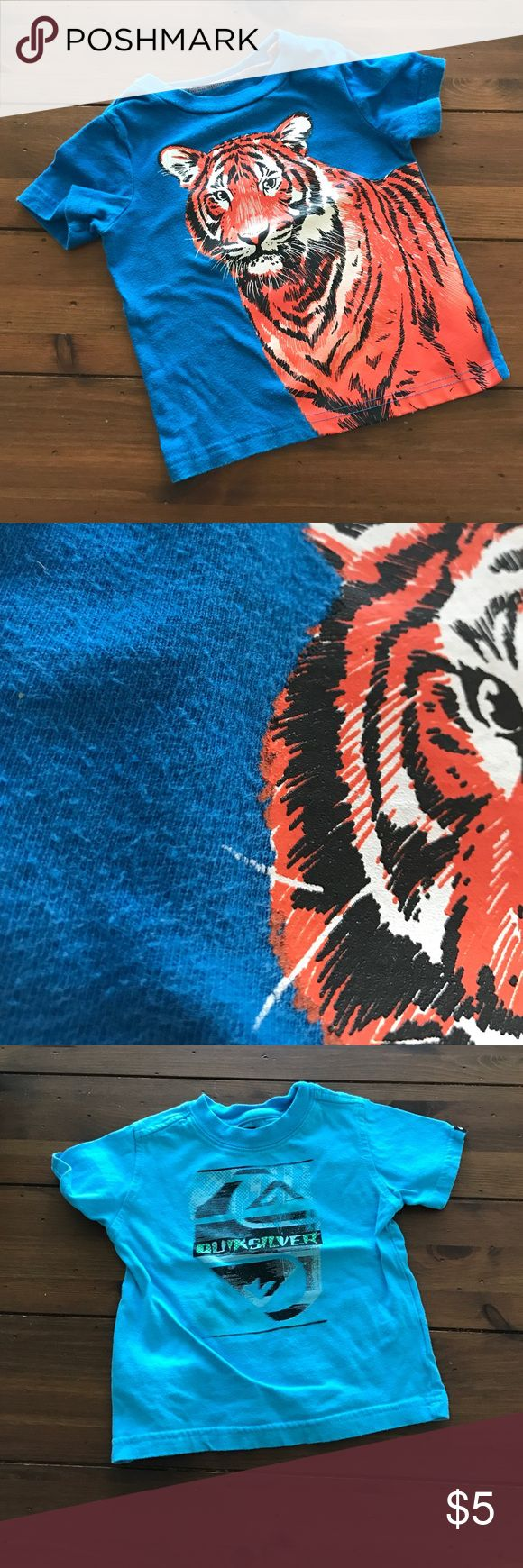 Circo Tiger Graphic and Quiksilver 2T Tee Lot Circo Tiger Graphic and Quiksilver Graphic Tees • Both have same information - Size: 2T • 100% Cotton • Machine Wash • Very Good Condition: Just some pitting on Tees - no stains, rips or holes! Quiksilver Shirts & Tops Tees - Short Sleeve