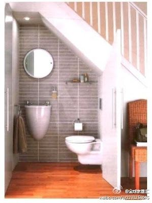 WC under stairs.   Take advantage of the empty space.