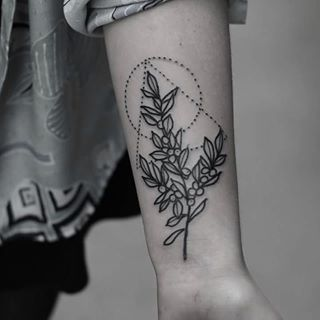 This geometric branch. | 22 Delicate Botanical Tattoos You Should Get This Spring