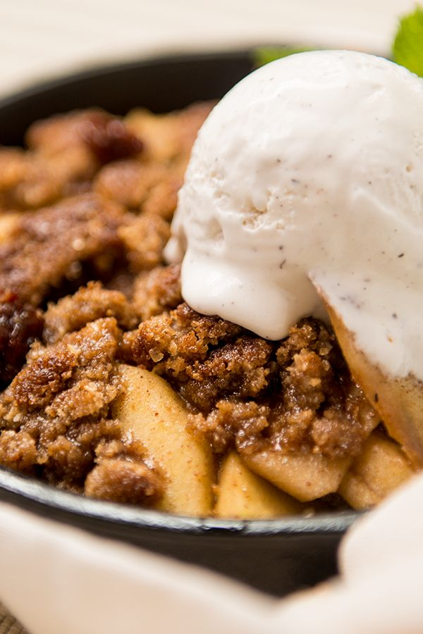 This barbecue Smoked Skillet Apple Bourbon Crisp takes Grandma's Apple Pie to the Honky Tonk. Baking it on the grill allows it to caramelize and soak up warm and smoky tones for blue ribbon flavor.