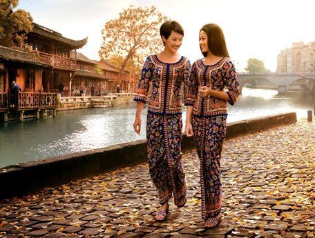 "In the early 1970′s Pierre Balmain was commissioned by Singapore Airlines to re-design the flight attendants' uniforms, and thus created the iconic ""Singapore Girl,"" whose look was loosely based on the traditional Indonesian costume, kebaya."