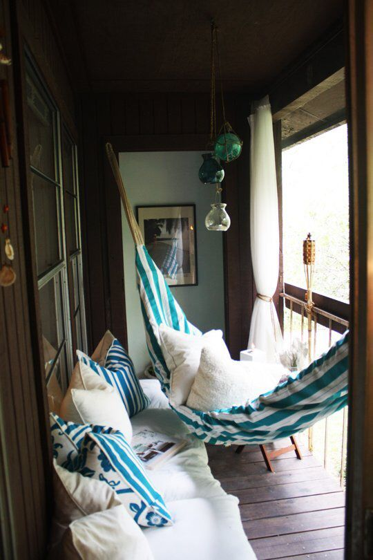 Covered outdoor nook with privacy curtains
