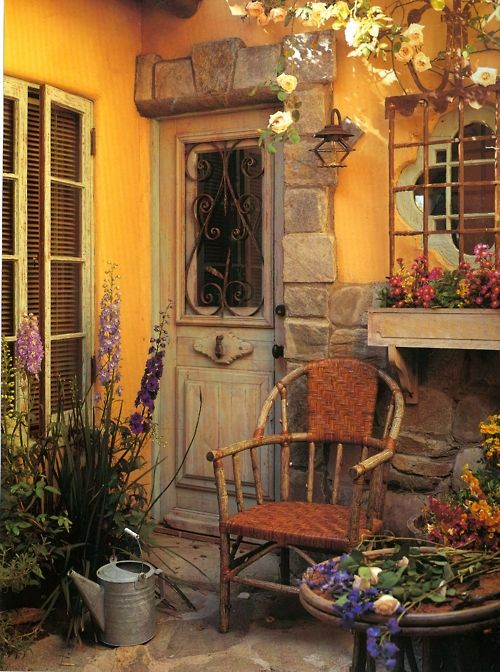 Doesn't this totally make you think of Under the Tuscan Sun? I love this little space, with the sunny yellow wall - and ADORE the chair.: Doors, Window, Cottage, Outdoor, House, Space, Place, Garden