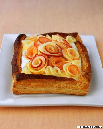 """Buttermilk Cream Tart with Apple Roses -""""It's as nice a Valentines' Day present as a bouquet of roses, but even sweeter -and without any thorns.  Delicate pouched apple slices, rolled up into blooms, make a showy arrangement atop a cloud of buttermilk cream, all tucked into flaky puff pastry."""" - Martha Stewart"""