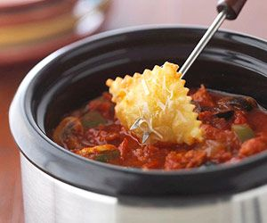 Supreme Pizza Fondue: pizza-flavored appetizer dip - perfect for any party. Dip ravioli, cheese cubes, hearty grain crackers or bread cubes, etc...