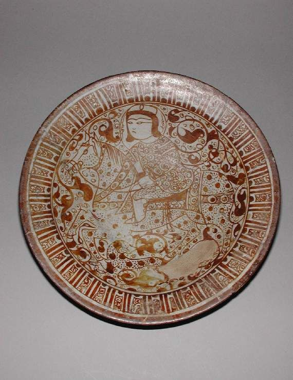 Maker(s) & Production:  Unknown, potter, Iran, Kashan, probably Kashan  Collection:  Henry Scipio Reitlinger  Category:  fritware/stonepaste  Name(s):  dish Islamic pottery; category lustreware; category  Date:  circa 1179 — 1198  School/Style(s):  Seljuk; miniature style  Period:  late 12th Century
