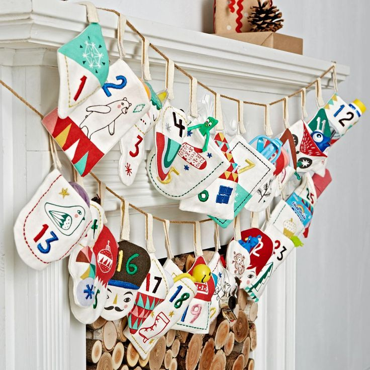 Shop Good Cheer Toy Advent Calendar.  The various pouches on this soft kids advent calendar will bring plenty of cheer into your home this holiday season.  Each one features a different festive design that's perfectly sized to hold a treat.