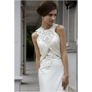 1. Robe de cocktail originale look mariage créateur collection 2011:Robe blancheAgrémentée de broderie et perlesDos nu d'un partie