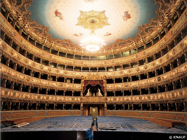 Opera at Teatro La Fenice (Italy). 'Wraps shed in lower-tier boxes reveal jewels and Murano-glass baubles, while in top loggie (balconies), loggione (opera critics) predict which singers will be in good voice, and which understudies merit a promotion. Meanwhile, architecture aficionados debate whether the theatre's baroque reconstruction after its 1998 fire was worth the €90 million.' http://www.lonelyplanet.com/italy/venice/sights/opera/teatro-la-fenice