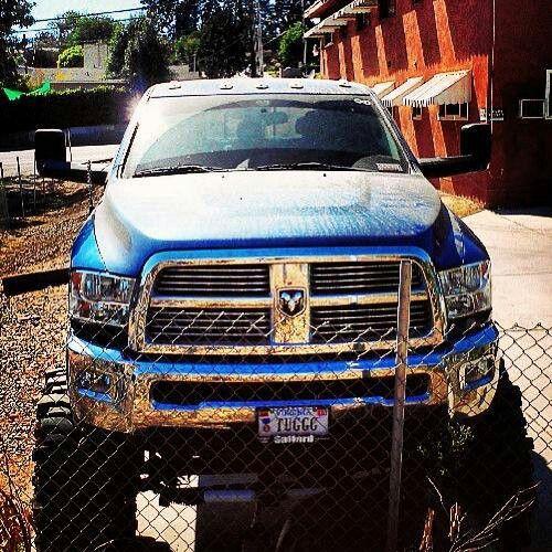 Beautiful new lifted Cummins Dodge on mud tires. Plenty of nice chrome, too.