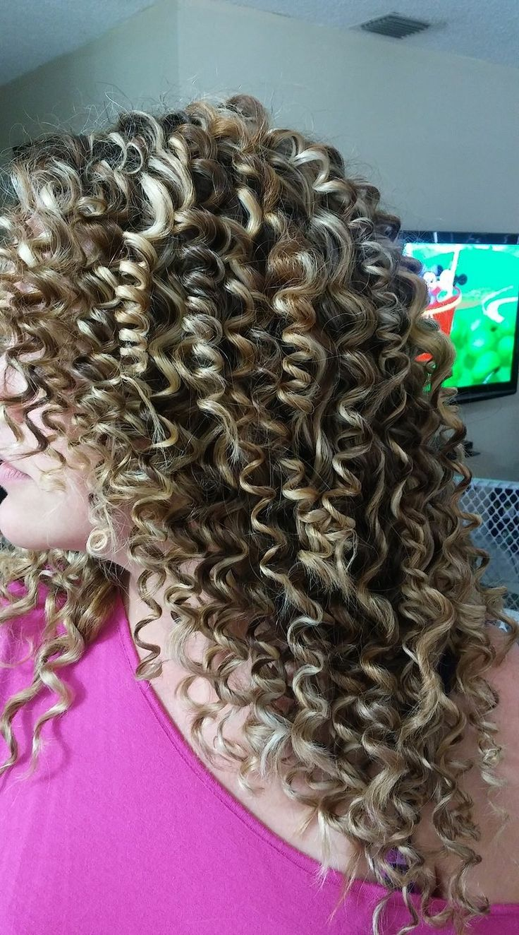 Get Afro Cuban curls by wrapping small strands of hair around a pencil and heating them with a straightener!!!!