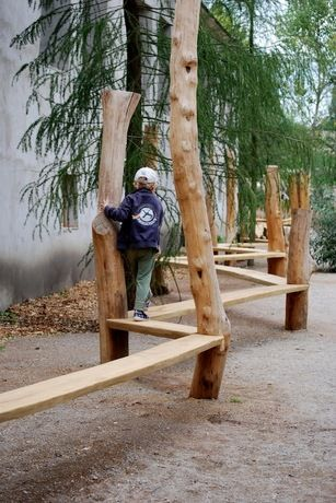 Garden path playground. Could work something similar between some of the trees back in the forest too