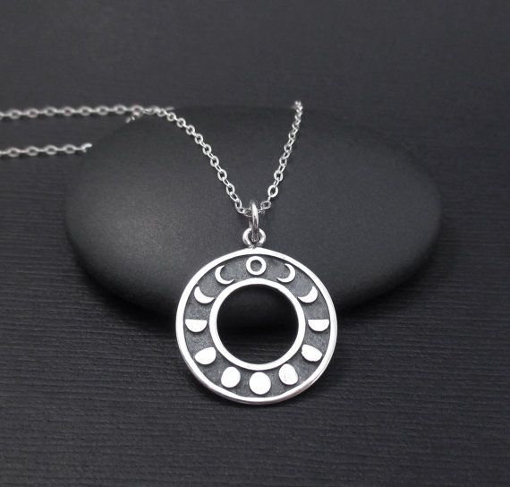 Beautiful necklace featuring an etched sterling silver Moon Phases charm and sterling silver chain. The charm measures 11/16 (about the size of a penny) in diameter. It is partially oxidized to bring out detail. The charm is attached to a delicate 1.3mm sterling silver flat cable chain with a permanently closed ring. The chain features a sterling silver spring ring clasp closure and it is .925 hallmarked. Chain length: 16,18 or 20. The wire and all other metal components on this necklace...