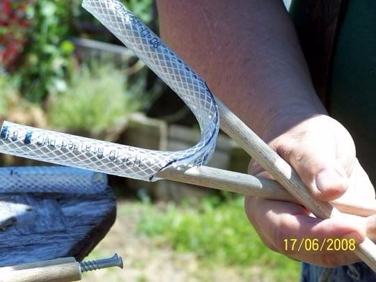 Shooting Sticks by faucettb -- Homemade shooting sticks constructed from wooden dowels and braided plastic hose. http://www.homemadetools.net/homemade-shooting-sticks-3