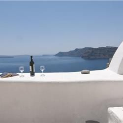 Vip Suites Hotel is built on the rocky cliff of picturesque village of Oia, Santorini, Cyclades, Greece.