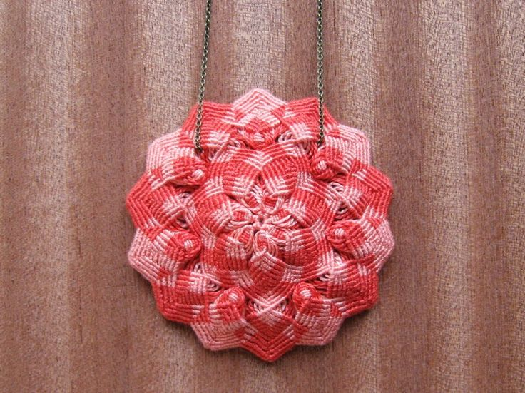 Knotted Flower Pendant (it's really just made of one element repeated, but by doing so in a round array the effect is much more dramatic).