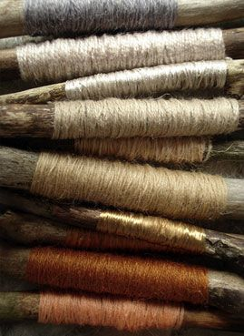 beautiful yarns and threads on rough-hewn wooden bobbins