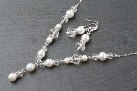 Bridal Necklace, Bridal Y Necklace, Crystal Wedding Necklace, Bridal Jewelry set, Pearl Wedding Necklace, Swarovski Crystal Y Necklace This stunning y drop wedding necklace is made with sparkling crystals, glass pearls and rhinestone spacers. Each segment is wire wrapped with sterling silver wire onto sterling chain and lobster clasp. Necklace measures 18 Are you looking for a specific color combination? Let me design something elegant and unique for your special day. Just send me a message…