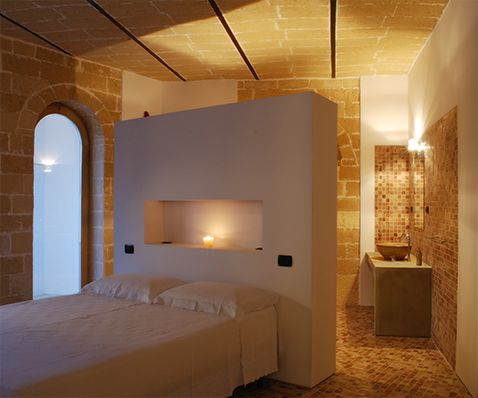 Architecture. mediterranean house renovation. A project by OfficineMultiplo. #pietra #stone pietra leccese #bedroom #romantic