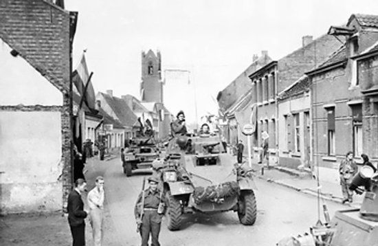 Caption: Canadian Daimler and Humber armored cars in the Belgian-Dutch border town of Putte, during the Anglo-Canadian drive to cut off the German 15th Army on the islands of the Scheldt Estuary, 11 Oct 1944; Source: Imperial War Museum; ID: 4700-05 HU 69103.