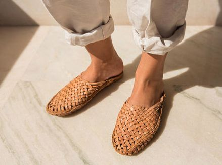 Traditionally worn by men and referred to as Kolhapuri Bunto, this style dates back to generations and are handmade in India using camel leather. Comfortable for everyday - use at home or wear it out. Comes in a yellow-toned camel color.