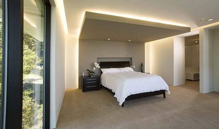 try use of wall and cove lighting. Instead of a chandelier or pendant light helps the ceiling look higher than it is and creates ambiance