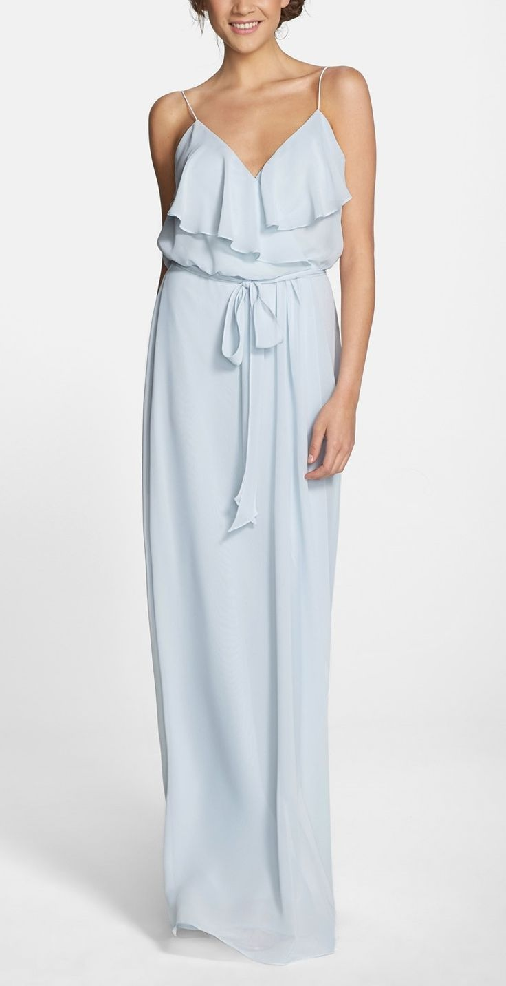 Loving this pale blue gown for a soft and romantic vibe. The ruffled-overlay and wrap-style skirt flatter the figure, while a coordinating tie belt defines feminine curves.