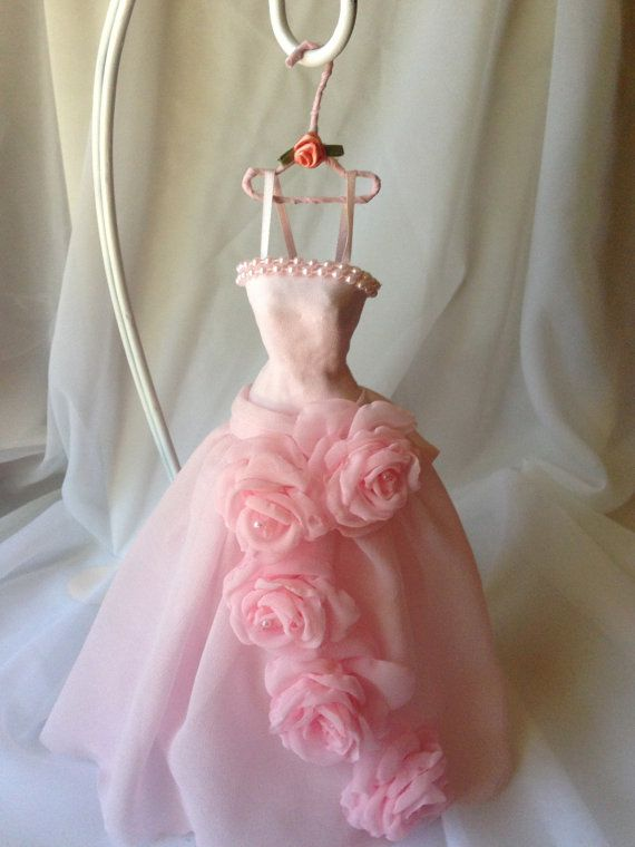Miniature paper mache (top) dress made from pink chiffon and decorated with string pearls and handmade chiffon fabric roses.    Dress is 10 1/4