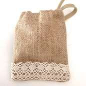 Hessian Gift bags and corporate bags Lace Hessian favour bags, perfect for a Rustic wedding, orprinted hessian favour bags. You can personalise your wording and wedding date. The bags are 14cmL x 9cmW complete with a twine draw string and hessian flower.For corporate gifting we have a hessian string bag made from fine weave hessian. Printed with a picture logo of your choice. Size can also be amended according to your needs.