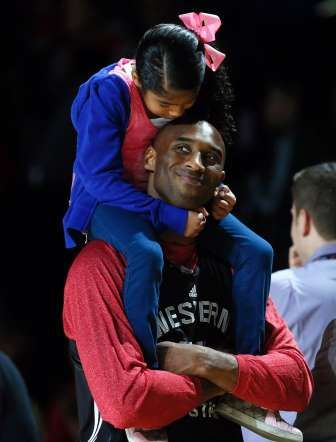 Los Angeles Lakers Kobe Bryant holds his daughter Natalia. - LUCY NICHOLSON/Newscom/Reuters