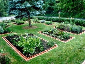 Raised garden beds can help you keep the clean lines you may be looking for while providing space to nurture your own produce.