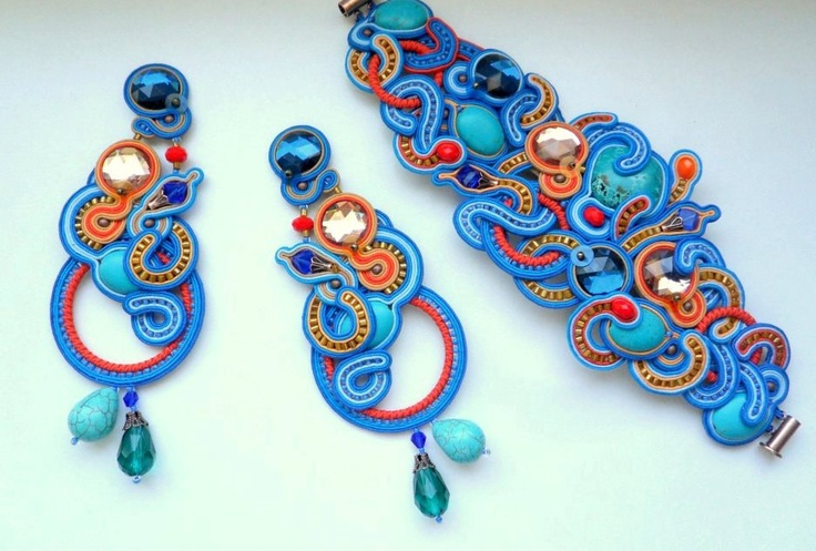 SOutache cuff with turquoise flat crystals orange blue deep colour. £82,00, via Etsy.