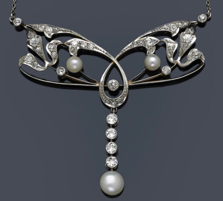 An art nouveau cultured pearl and diamond necklace, circa 1910  estimated total diamond weight: 2.40 carats; mounted in platinum-topped eighteen karat gold; length: 15 1/4in. http://www.bonhams.com/auctions/18681/lot/466/?page_anchor=MR1_page_lots%3D6%26MR1_results_per_page%3D50%26MR1_module_instance_reference%3D1