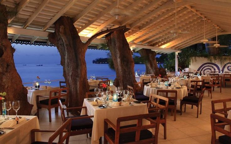 The Tides restaurant in Holetown, Barbados, retains a relaxed, informal feel despite its reputation as one of the best restaurants in the country. Open-air and ocean-facing, with trees growing the roof, the setting is dramatic; seafood dishes with Asian touches are The Tides' speciality.