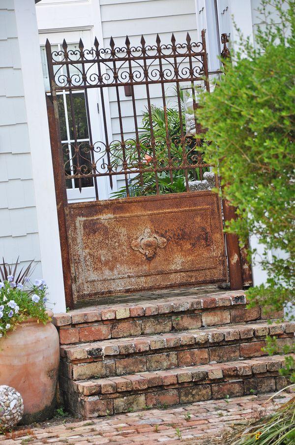 god I loveee this - rust, stone, gate....