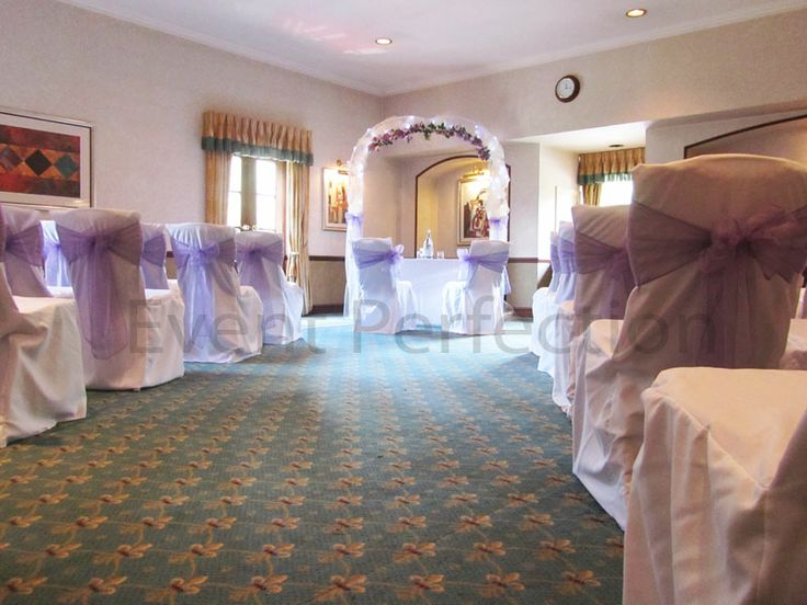 The aisle of the ceremony room leading down to the ceremony table and wedding arch