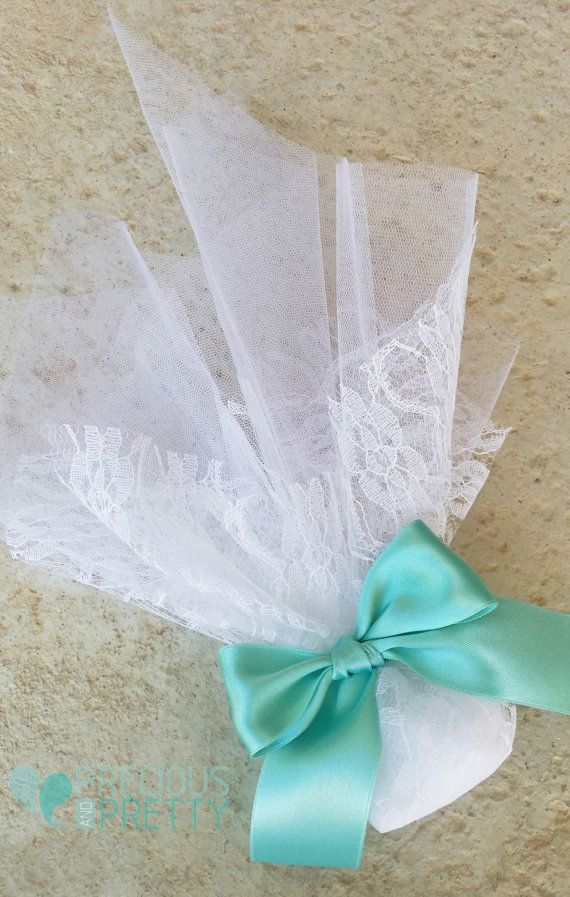A romantic wedding favor with white lace and aqua blue ribbon #weddings #favors #greece #romantic #aquablue #bombonieres #preciousandpretty