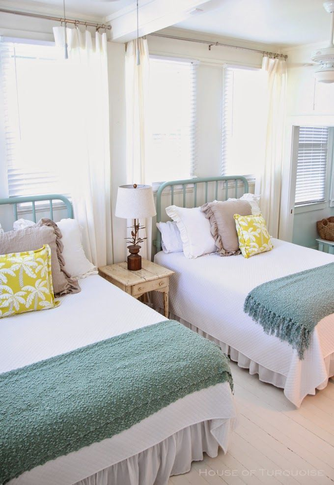 Bright and beach-themed twin beds in a guest rom