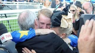 Tommy Berry locks in a tight embrace with his parents after his Sydney Cup success. 19/4/14