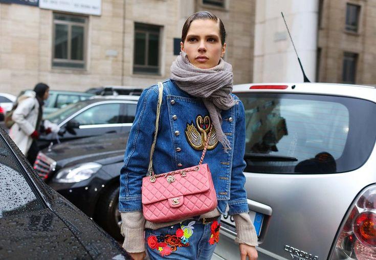 Street style Milan Louis Vuitton bag and denim military jacket