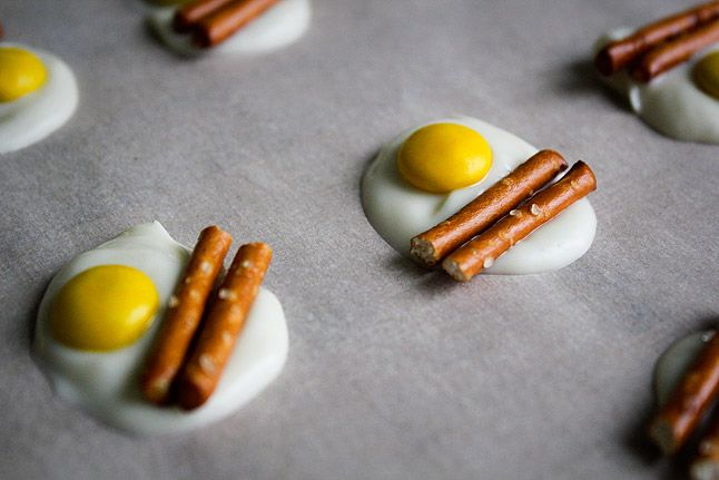 """Bacon and Eggs"" Candy. White chocolate, yellow M&Ms, and pretzel sticks"