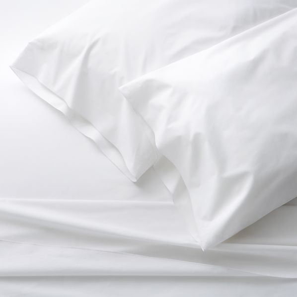 Clean, basic white bedding upgrades in soft, smooth cotton percale, beautifully accented with a graceful overlocking embroidery stitch on the flat sheet and pillow case. Generous fitted sheet pockets accommodate thicker mattresses.